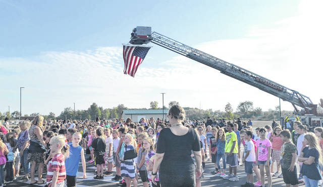Nearly 1,600 Greenville elementary and middle school students, along with the school's staff, observed Patriots Day on Wednesday in honor of the 18th anniversary of 9/11. The Greenville Fire Department provided their ladder truck and American flag as the backdrop to the school's annual event.