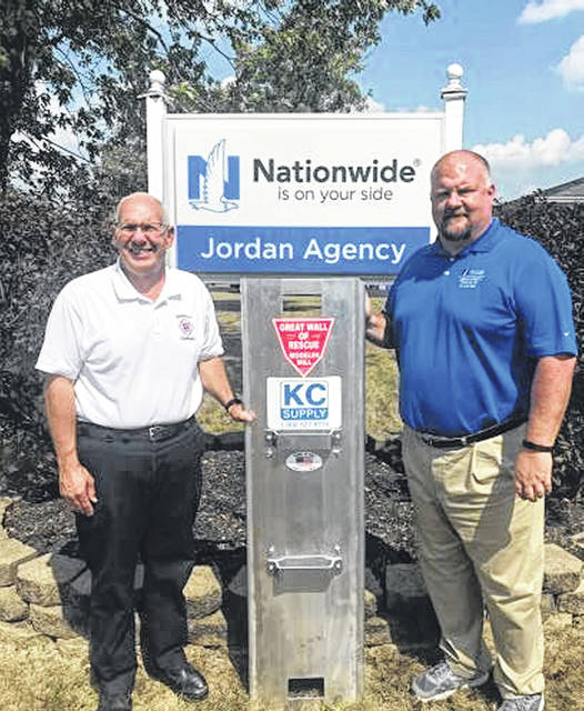 Above left. Greenville Township Emergency Services Administrative Chief Steve Wenning and Matt Jordan with Nationwide Insurance pose with the new grain rescue tube presented to the township as part of the insurance company's Grain Bin Safety Program.