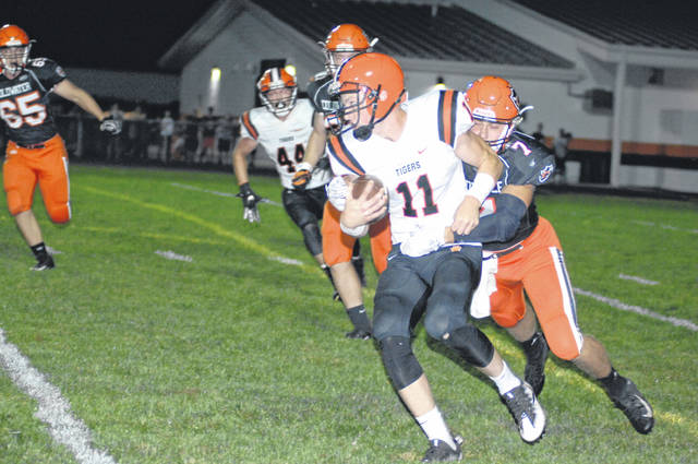 Versailles gets a gain against Coldwater in MAC play.