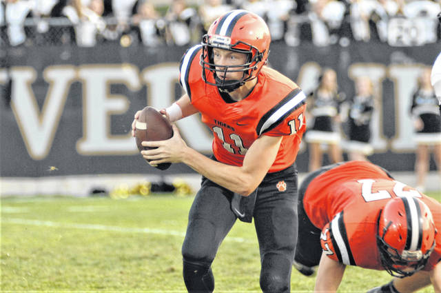 Ryan Martin carries the ball for Versailles in win over Parkway.