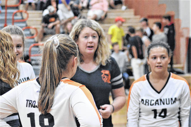 Arcanum coach Macey O'Dell talks to her team during a timeout at National Trail.