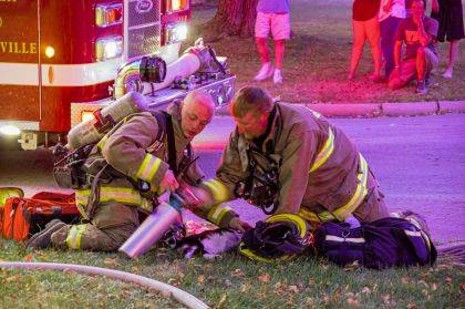 Firefighters work to save a family pet after a two-alarm fire.