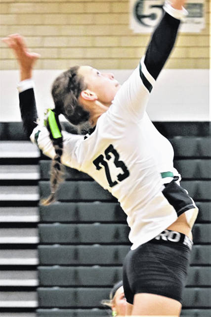 Abbie Yoder slams a kill for the Lady Wave in MVL play with the Lady Trojans.