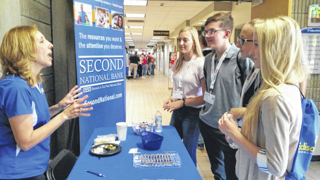 Brandy Rhodehamel, banking officer/lender for Greenville's Second National Bank, speaks with a group of Greenville High School students about career opportunities during Friday's Inspire Career Concert at the Piqua Campus of Edison State Community College.