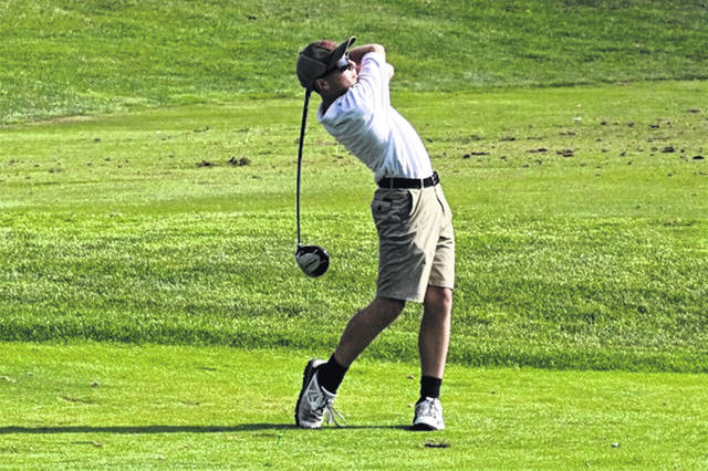 Greenville's Lukas Francis tees off for the JV boys golf team.