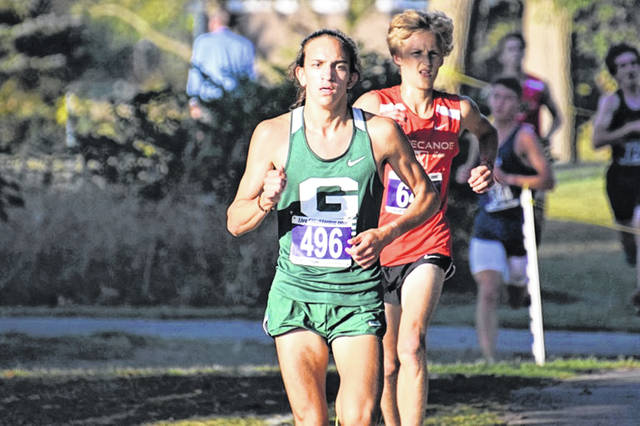 The Green Wave's Riley Emerick places third out of 162 runners in the boys cross country event at the Piqua Invite.