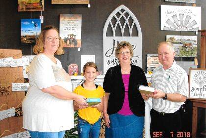 Shown are Michelle Raffel, of Bread of Life, Elise Hahn, Vivian Dailey, president of Darke County Weekday Christian Education, Inc., and Harold Keller.