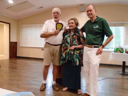 Shown are Ed Curry, Annie Oakley Golf Tournament Committee Chairman, Bettye Laughlin and Ray Laughlin.