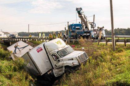 A crane operator was called into help remove a semi-tractor and trailer from Swamp Creek.