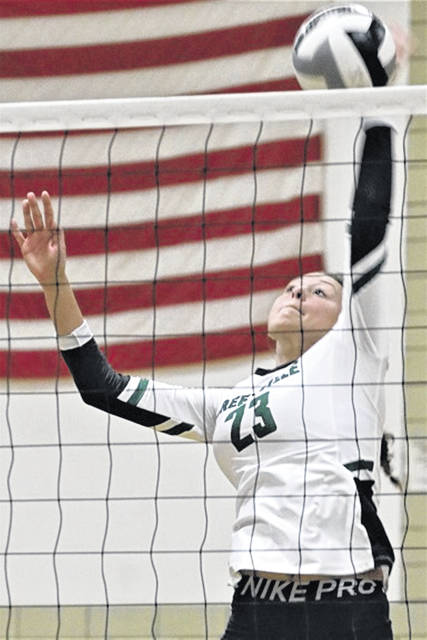 Greenville's Abbie Yoder sets new 'block kill' varsity volleyball record for the Lady Wave in MVL win over the Piqua Lady Indians.