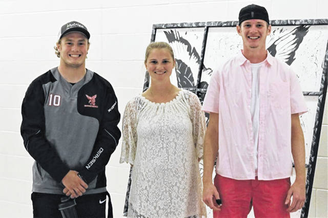 Cody Dirksen and Blake Scholl recently set Mississinawa Valley varsity football records. (L-R) Cody Dirksen, MV Athletic Director Mackenzie Dirmeyer and Blake Scholl.