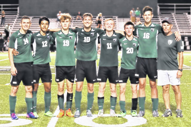Greenville senior soccer players L-R: Andrew Bonfiglio, Axl Rodriquez, James Fields, Kaleb Poe, Alex Hutt, Andrew Stachler, Josh Galloway and Coach Mark Coppess.