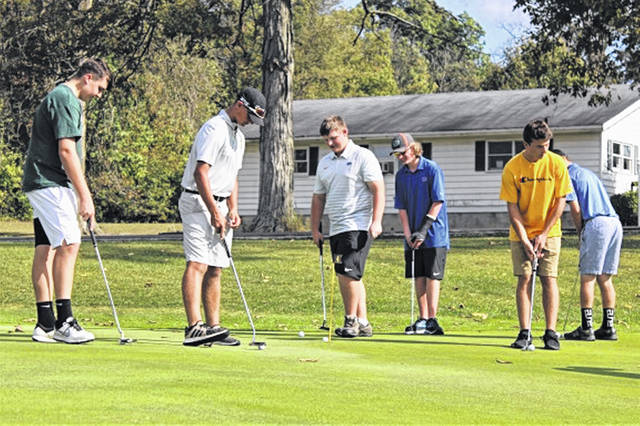 The Greenville boys golf team gets in a Wednesday afternoon practice at Turtle Creek Golf Course.