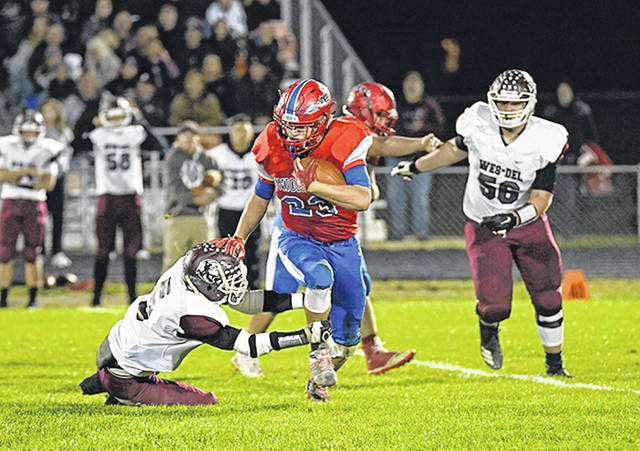 Union City Indians running back, Jayden Hindsley runs for yards in the teams 30-28 sectional win over Wes-Del.
