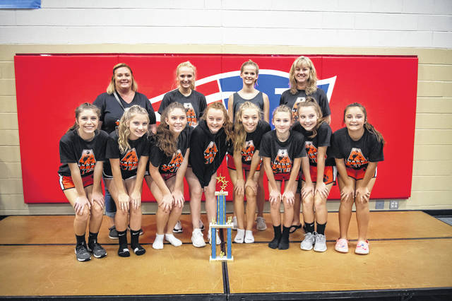 Ansonia's junior high cheerleading team earn All-American Patriot champions.