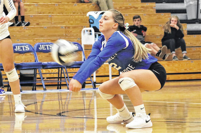 Belle Cable picks up her 1,000th career dig for the Franklin Monroe Lady Jets in the team's Monday night non-conference win over the Houston Lady Wildcats.