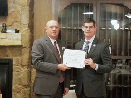 Gregory Bruns accepted his diploma after completing Bank Management School.
