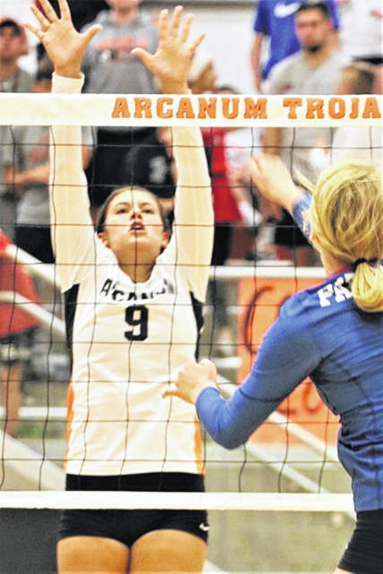 Arcanum senior Camille Pohl goes up for a block in the Lady Trojans senior night win over the Lady Patriots.