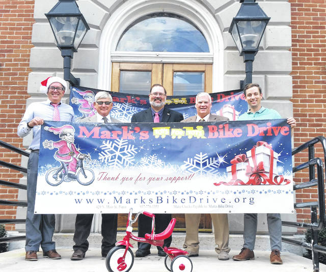 Darke County Commissioners are supporting Mark's Bike Drive, which will provide new bicycles for children in Darke County. Above, left to right, drive organizer Mark Reedy, commissioners Mike Rhoades, Matt Aultman and Mike Stegall, and Josh Reedy.