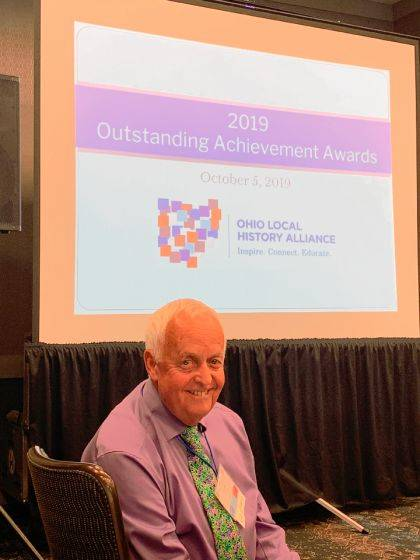 Dick Brown accepted an award as Champion of Local History at the Ohio Local History Alliance's annual conference.