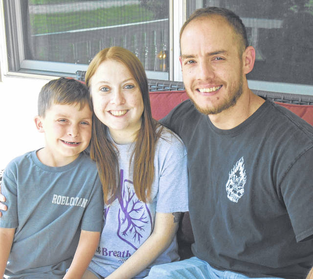 Ronnie Whitehead is shown with her son, Colin, and husband, Matt.