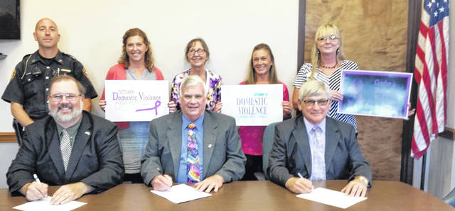 County commissioners on Wednesday signed a proclamation in observance of National Domestic Violence Month. Front row, left to right, Matt Aultman, Mike Stegall and Mike Rhoades. Back row. Darke County Sheriff Sgt. Tony Royer, and representatives from the Darke County Shelter From Violence Shelter Katrina Angle, coordinator Annie Sonner, Paula Harman, and Traci Riley.