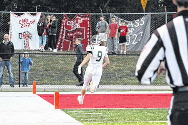 Alec Fletcher turns an interception into the game's first score of the night in Greenville's win over the homestanding Tippecanoe Red Devils.