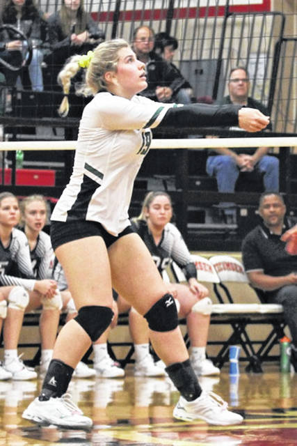 Hunter Class makes a set for Greenville in the Lady Wave's sectional tournament match.