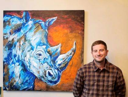 Miles Huston is show with his oil painting, Rhino.