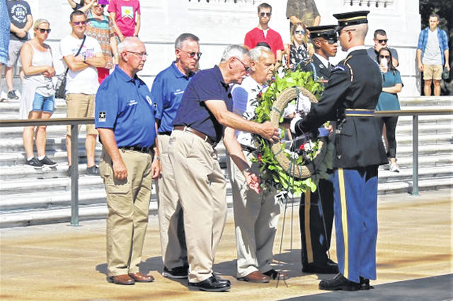 Darke County Veterans lay the wreath a the Tomb of the Unknown Soldier at Arlington National Cemetery. Front row, left to right, Walter Nieport and Dan Toth. Back row, left to right, Darke County Veterans Services Commissioners Gaylen Blosser and Jack Sloat.
