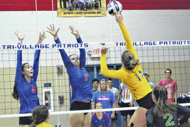 Madi Mead (L) and Maddie Downing (R) go up for a block in the Lady Patriots 3-0 non-conference win over the Northeastern Lady Knights.