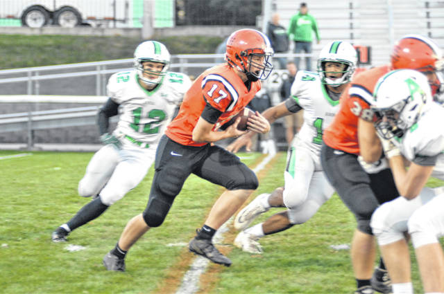 Landon Henry carries the ball for Versailles in homecoming game.