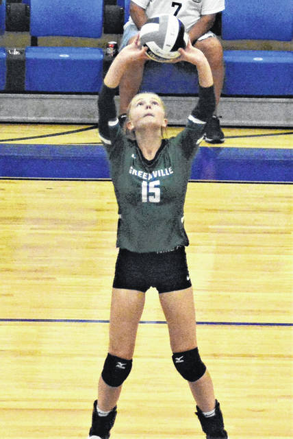Libby McKinney makes a set for the Lady Wave in MVL win over Xenia.
