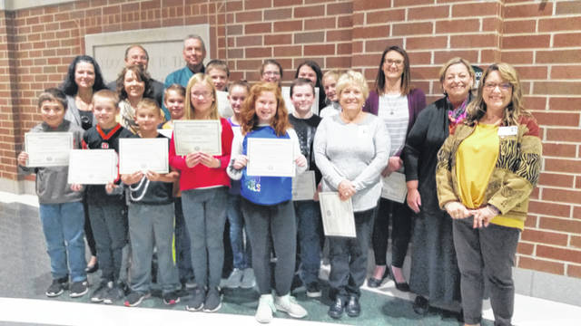 A dozen Greenville students now in grades 4-7 earned perfect scores in math in last spring's state testing. On Tuesday, Superintendent Doug Fries and Assistant Superintendent Laura Bemus, math teachers and building principals presented students with certificates of achievement and gathered for a group photo.