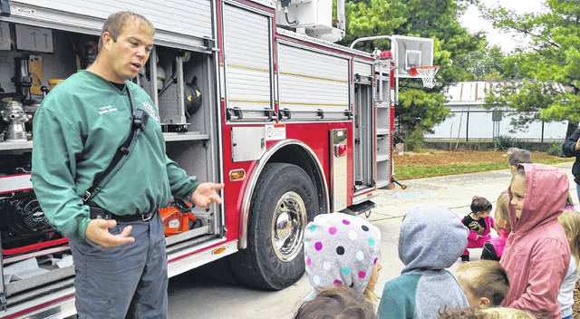 Greenville Fire Captain Daniel Myers gave a tour of the department's ladder truck with DeColores Montessori preschool and kindergarten students on Monday.