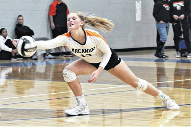 Taylor Gray makes a diving save for Arcanum in the Lady Trojans tournament win over state ranked Northeastern.