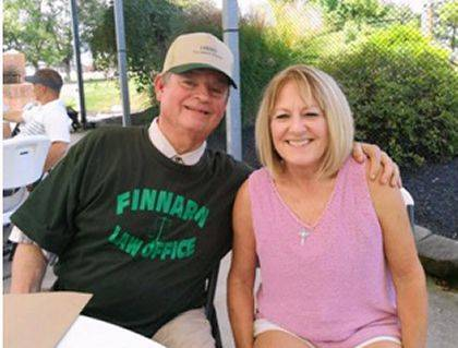 Ted Finnarn, attorney, one of the many sponsors of the K of C Golf Scramble is shown with Eileen (Buell) Schulze, daughter of the late Dennis Patrick (Denny) Buell, in whose memory the golf event was held.