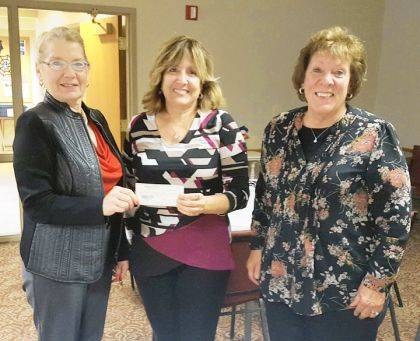 Darke County Republican Women's Club Treasurer Cindy Pike (L) and Wreaths Across America Chairman Katie Grow (R) present a check to Fort Greenville Chapter of the Daughters of the American Revolution Regent Debbie Nisonger (C). The donation will be used to purchase 10 wreaths to be laid during the Darke County Wreaths Across America event on December 14.