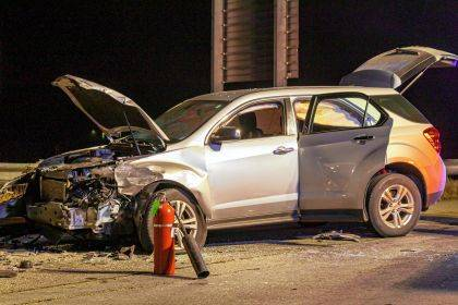 The driver of this Chevy Equinox failed to notice a disabled Dodge Ram truck before hitting the driver's side.