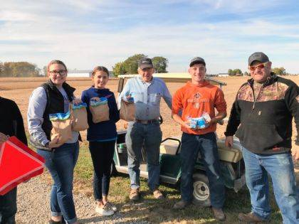 Laura Wuebker and Dakota Overholser are shown giving meals to area farmers.