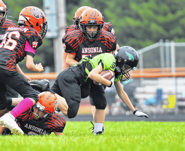 Greenville and Ansonia battle in the opening round of the Cross County Conference Yuth Football League playoffs.