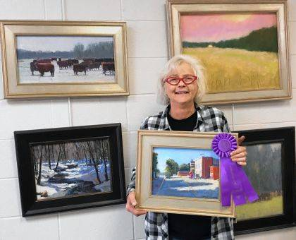 "UNION CITY, Ind. – Carol Strock-Wasson is shown at her Union City, Ind. studio with her winning artwork titled ""Main Street"" created at the plein air paint out in Lynn, Ind. on Oct. 5. A $500 purchase award was given by the Art Association of Randolph County. The pastel will be on display at the Arts Depot during the First Friday event on Nov. 1 from 5-7 p.m. at 115 N. Howard Street, Union City, Ind."