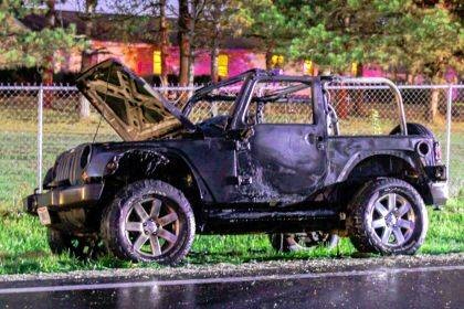 A New Paris man's vehicle caught fire and forced State Route 121 to close on Thursday evening.