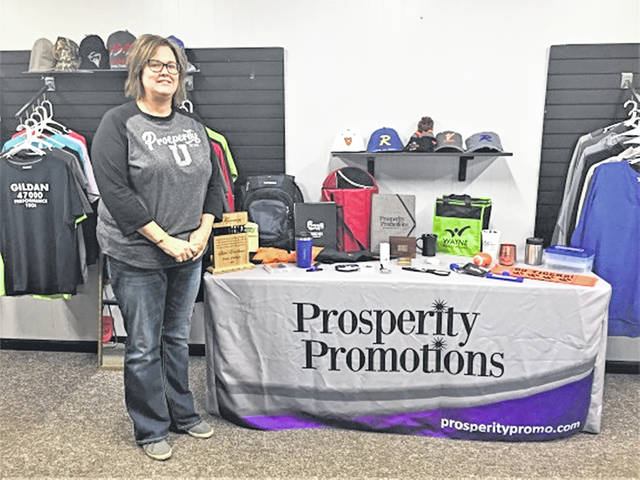 Former Versailles Lady Tigers JV basketball coach Kim Custenborder at her buisness; Prosperity Promotions in Versailles.
