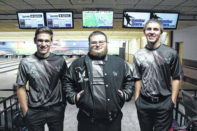 Mississinawa Valley bowler, Zac Lonfellow (R) takes first place with a 279 in WOHSBC Singles Tournament at Minster.