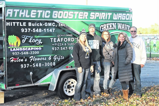 Greenville Athletic Boosters board members (L-R) Shellie Francis, Scott James, Denise Brandenburg, Jamie McGillivary and Randall Bowman with the Greenville Spirit Wagon at the Waves's 2019 Little Brown Jug win over the Sidney Yellow Jackets.