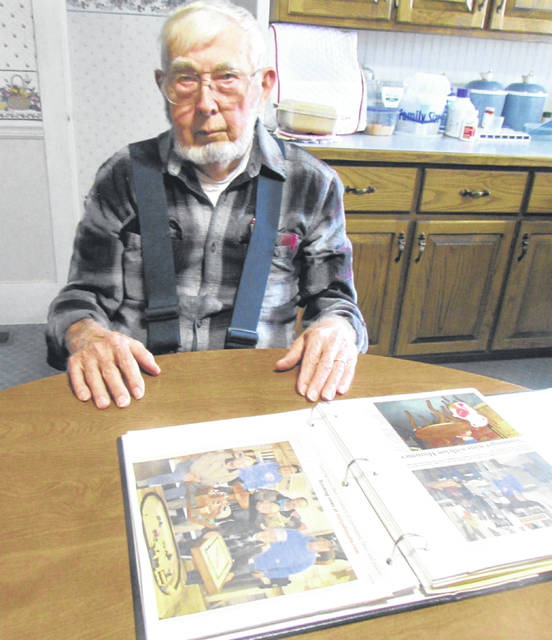 Harold Alley always enjoys entering the Wooden Toy Contest at the Ansonia Lumber Co. and hopes to get this year as well. It will be held Dec. 14. Also shown is one of the scrapbooks he has kept on the contest that has been going on for 26 years.