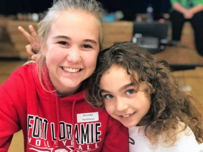 Big Buddy Brook Holthaus of Ft. Loramie enjoys a fun moment with her Little Buddy Carly at a session. Match Day gifts support the Big Buddies program.