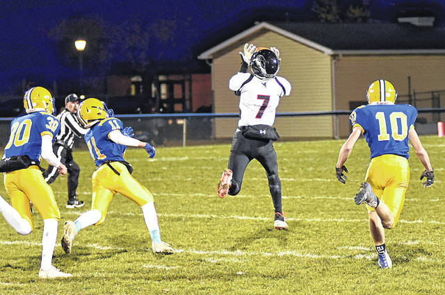 Blake Scholl pulls in a 75-yard touchdown pass from Mississinawa Valley quarterback Cody Dirksen in the team's playoff game at Marion Local.
