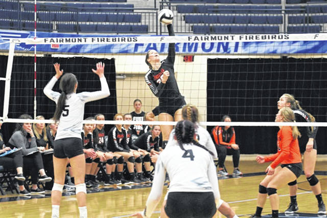 Brooke Stonebraker goes high for a kill in Versailles Lady Tigers regional tournament play.